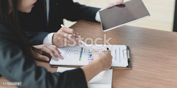 1068752548istockphoto Young business partner discussing the project together 1170240297