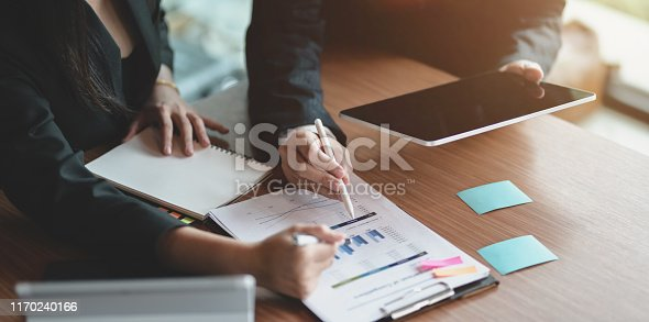 1068752548istockphoto Young business partner explaining the project with charts and graphs 1170240166