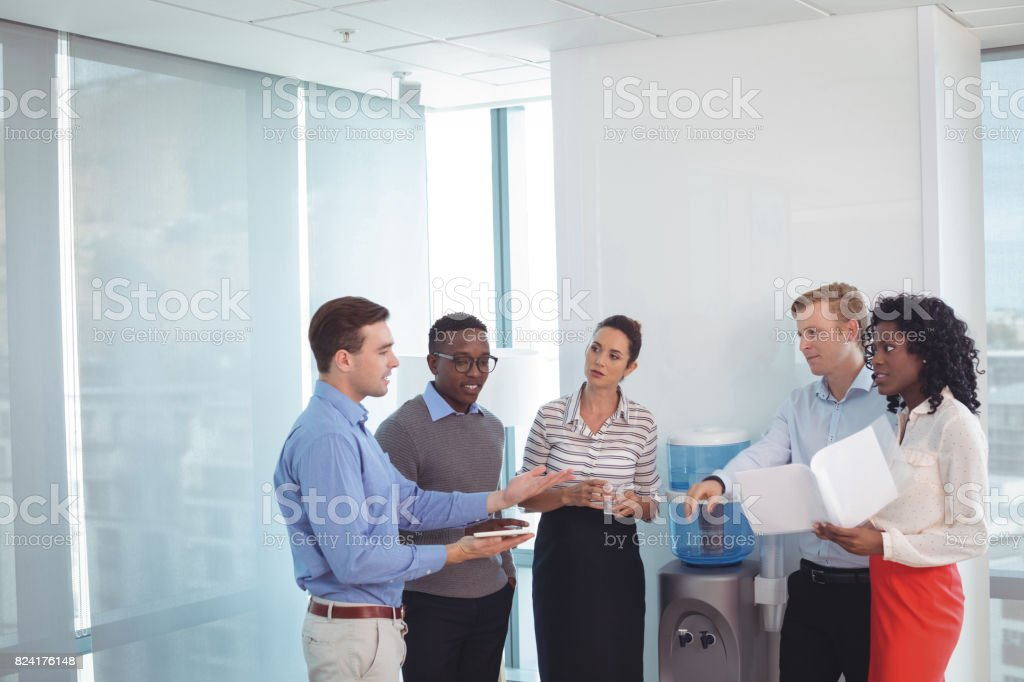 Young business partners discussing at office stock photo