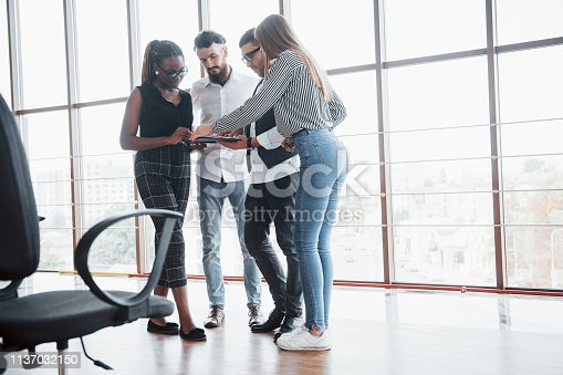 istock Young business people are discussing new creative ideas together during a meeting in the office 1137032150