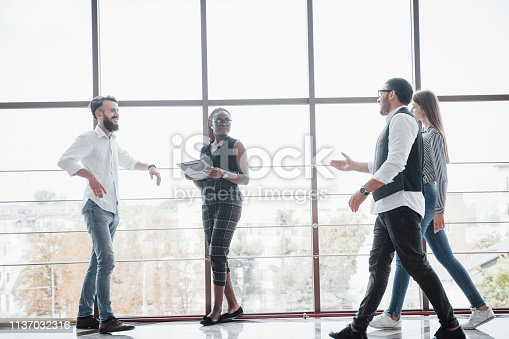 istock Young business people are discussing new creative ideas together during a meeting in the office 1137032316