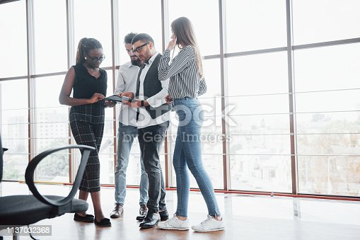 istock Young business people are discussing new creative ideas together during a meeting in the office 1137032368