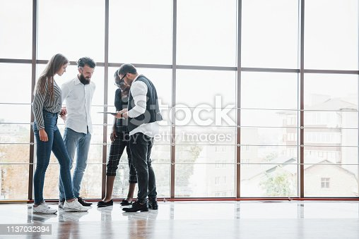 istock Young business people are discussing new creative ideas together during a meeting in the office 1137032394