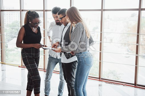 istock Young business people are discussing new creative ideas together during a meeting in the office 1137032587