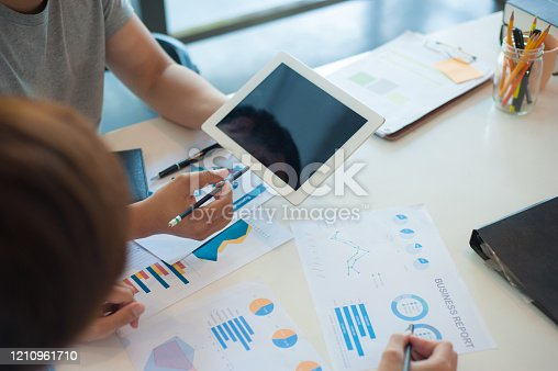 996183898 istock photo Young business people brainstorm ideas to analyze marketing strategies and plans. 1210961710