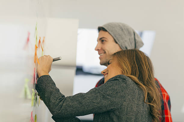 young business people brainstorming in their office. - gaucher photos et images de collection