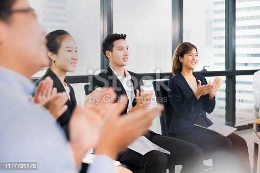 1016196912 istock photo Young business people clapping hands during meeting in office for their success in business work 1177791176