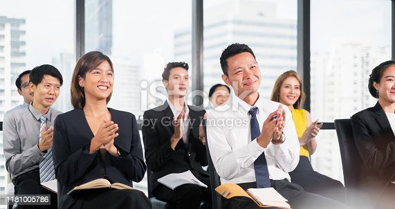 1016196912 istock photo Young business people clapping hands during meeting in office for their success in business work 1181005786