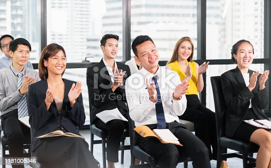 1016196912 istock photo Young business people clapping hands during meeting in office for their success in business work 1181005946