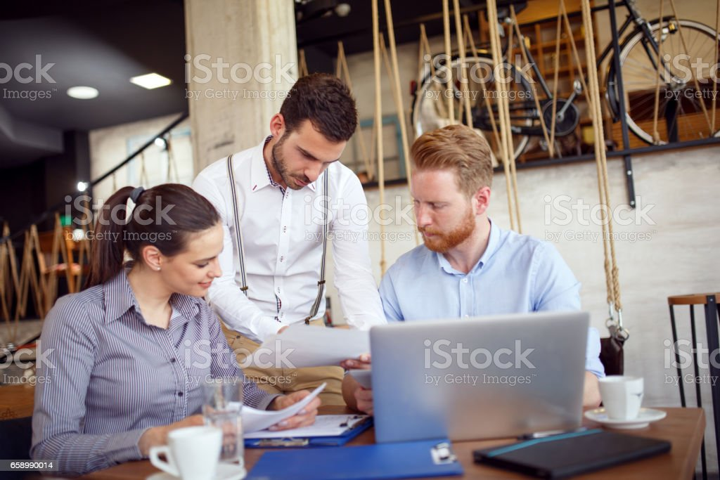 Young business people cooperating and brainstorming during coffee break. royalty-free stock photo