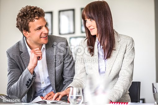 496441730 istock photo Young business people discussing at table in office 624410426