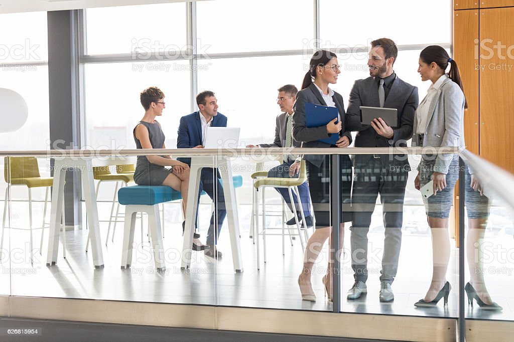 Young business people discussing business strategy using digital tablet stock photo