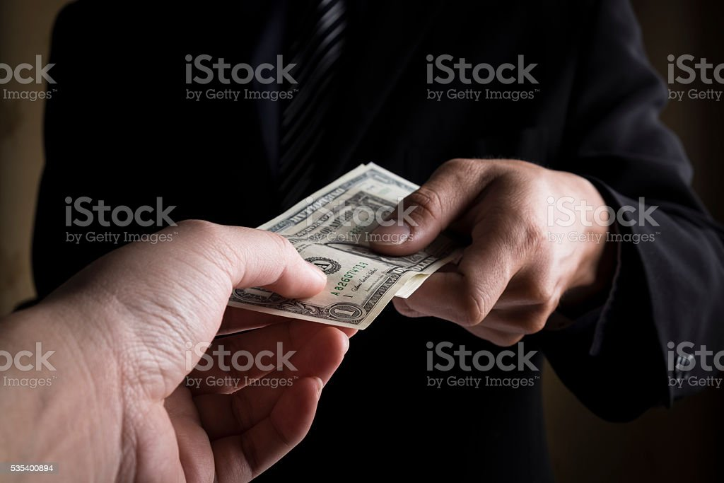 Young business people hands and money. stock photo