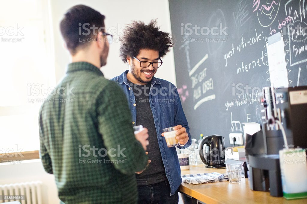 Young business people having coffee break stock photo