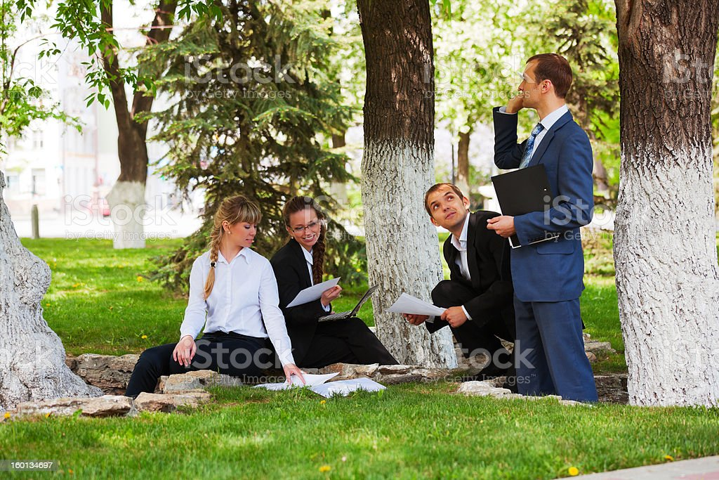Young business people in a city park royalty-free stock photo