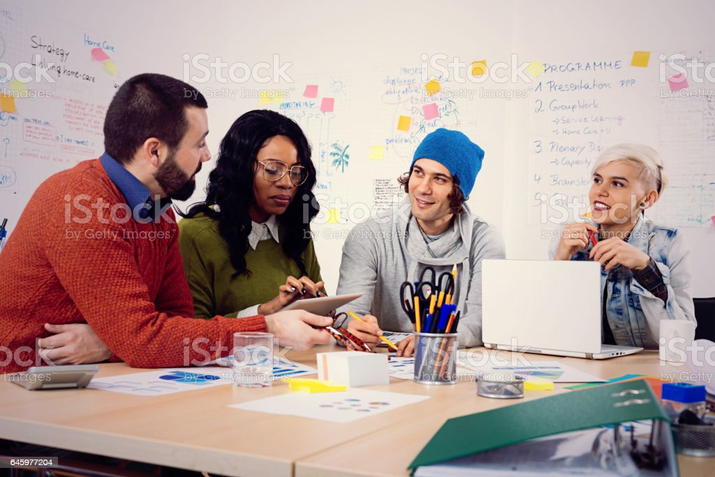 Young business people in office, developing start-up business ideas stock photo