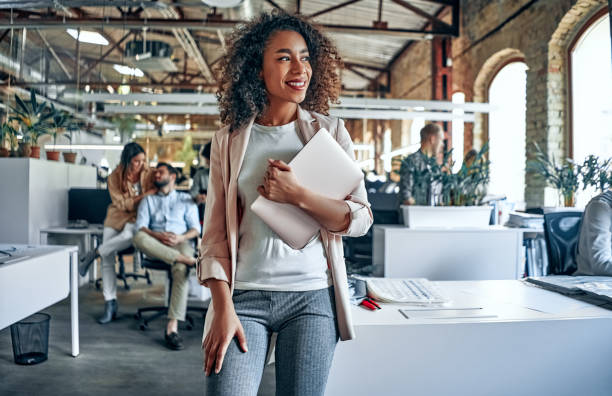 Young business people in office Group of young multiracial business people are working in modern office. Freelancers in coworking place. Creative and stylish youth. young adult stock pictures, royalty-free photos & images