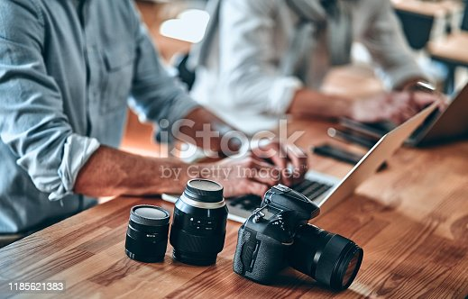 Young photographers in modern office with cameras. Creative and stylish youth.