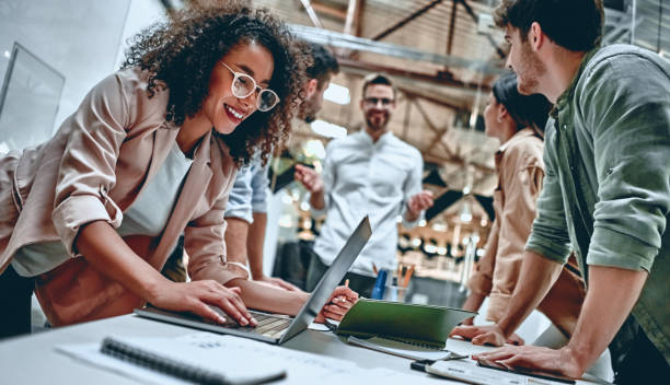 Young business people in office Group of young multiracial business people are working in modern office. Freelancers in coworking place. Creative and stylish youth. customs stock pictures, royalty-free photos & images
