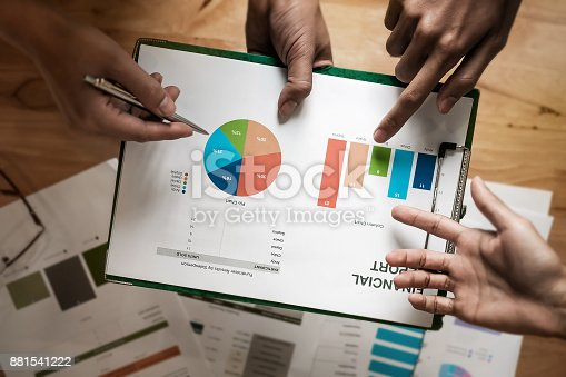 881542122istockphoto Young business people look at profit margins this month to analy 881541222
