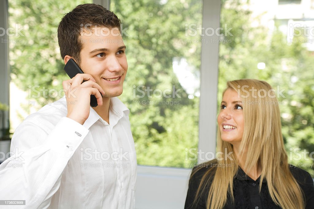 Young business people, man talking on the phone royalty-free stock photo