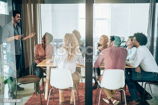 842214506 istock photo Young business people on meeting in board room. 1214358381