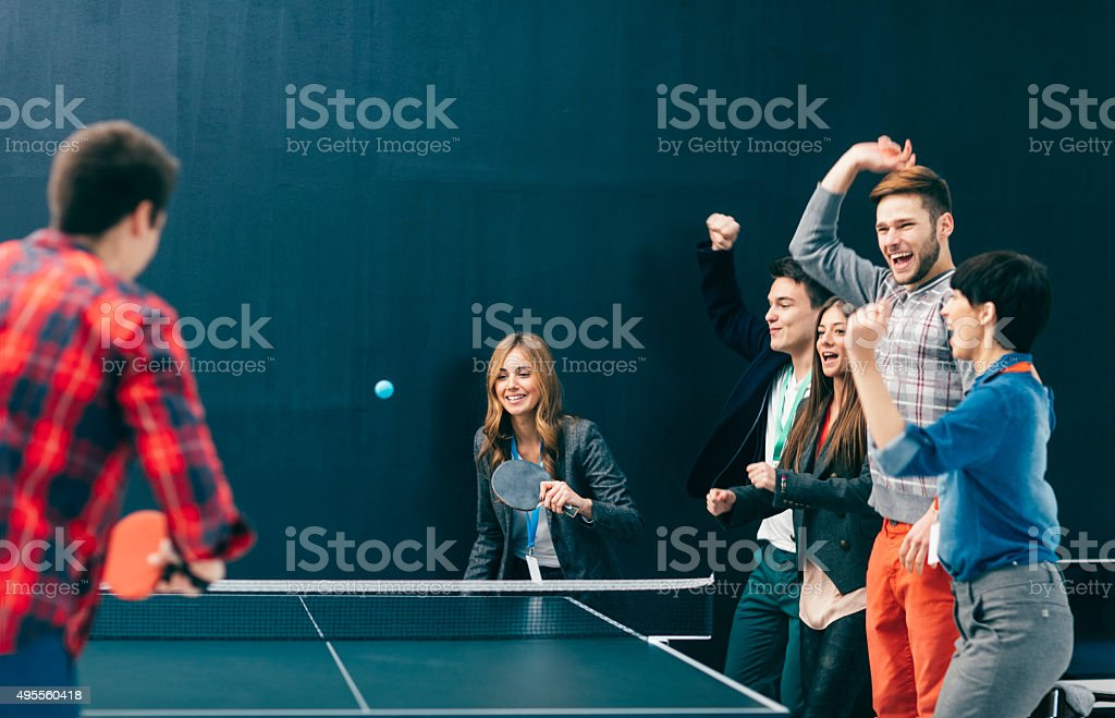 Young Business People Playing Table Tennis In Their Office. stock photo