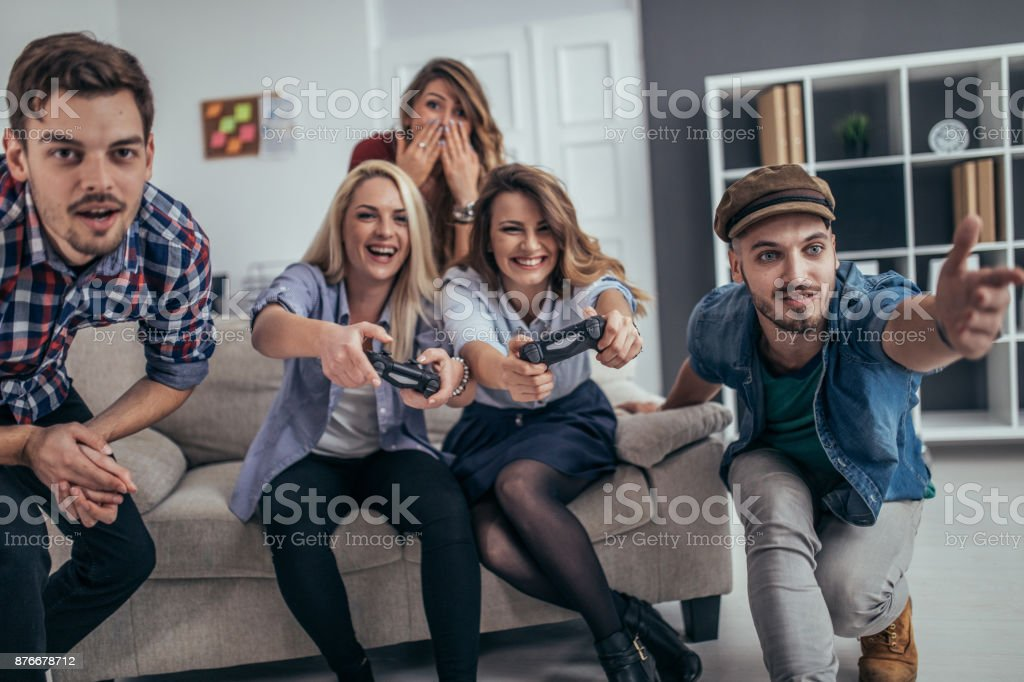 Young business people playing video games in the office stock photo