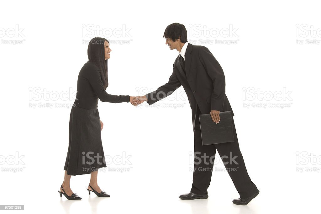 Young Business People Shaking Hands royalty-free stock photo