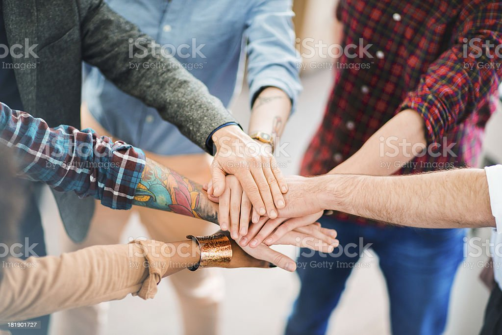 Young Business People Showing Team Spirit stock photo