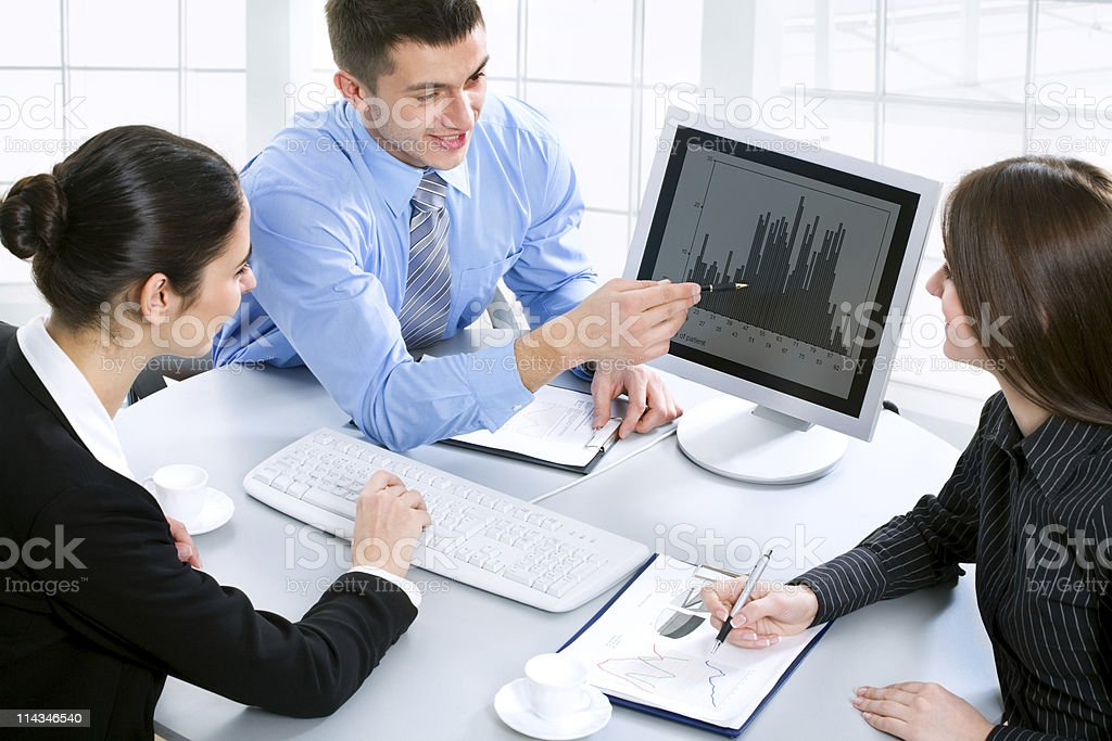 Young business people sitting in a meeting royalty-free stock photo