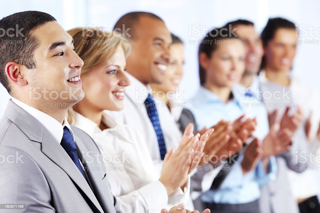 Young business people standing in the row and applaud. royalty-free stock photo