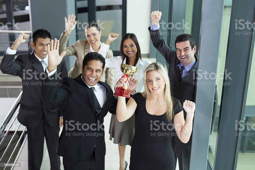 young business people wining a trophy royalty-free stock photo