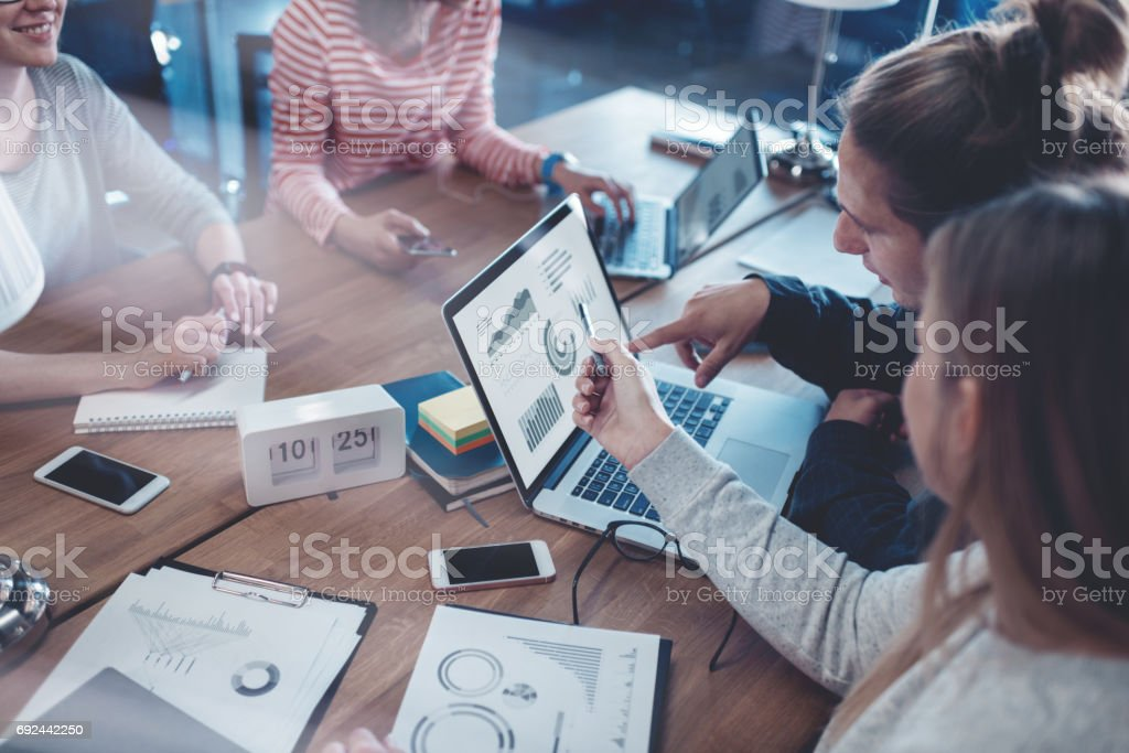 Young business people working together in the office stock photo