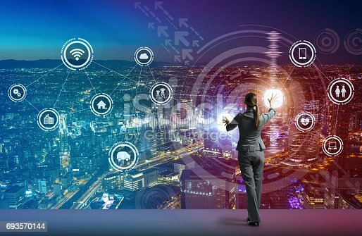 istock young business person and graphical user interface concept, Internet of Things, Information Communication Technology, Smart City, digital transformation, abstract image visual 693570144