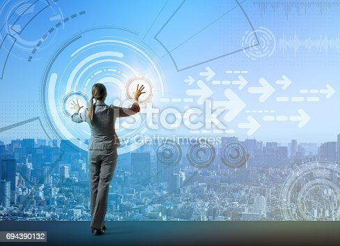 istock young business person and graphical user interface concept, smart city, internet of things 694390132