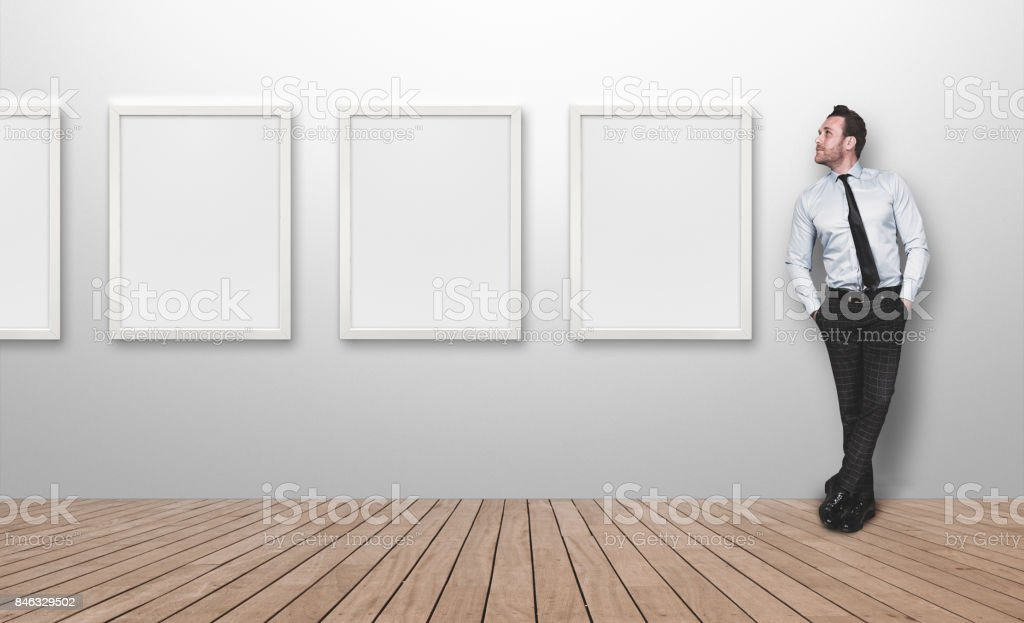 Young business person looking blank picture frames stock photo