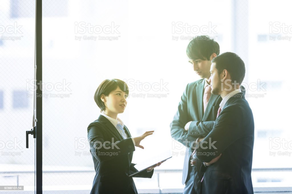 Young business persons in the office. stock photo