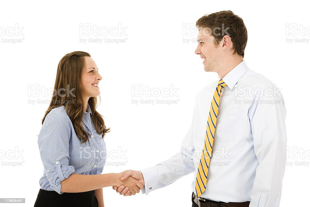 Young business professionals engage in a warm handshake businessman businesswoman royalty-free stock photo