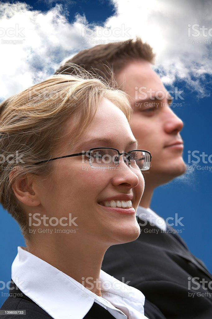 Young business rivals looking in different directions royalty-free stock photo