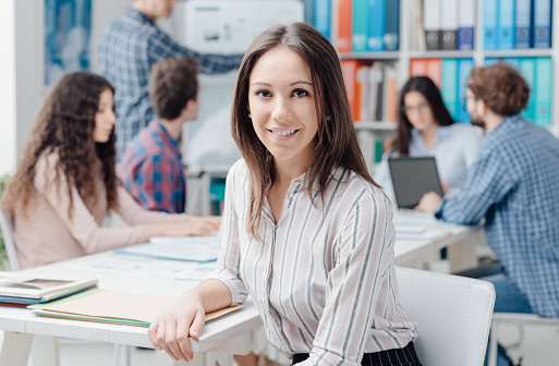 Young Business Team And Girl Smiling Stock Photo - Download Image Now