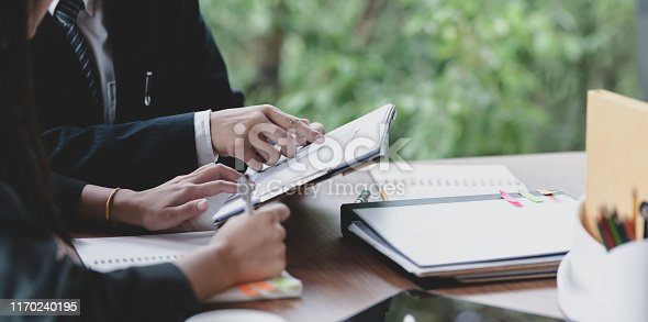 1068752548istockphoto Young business team brainstorming their strategy 1170240195