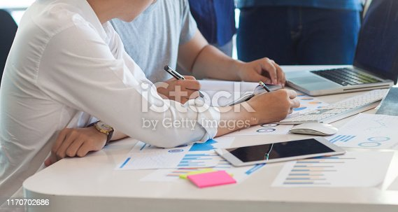 669853862 istock photo Young business team discuss and plan strategies for starting a new business project at the office. 1170702686
