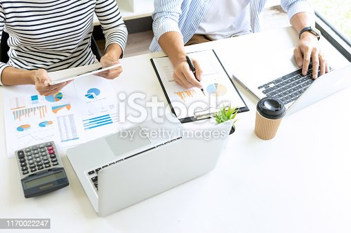 1079974636 istock photo young business team in a small meeting in the office 1170022247