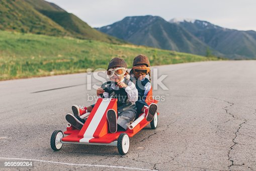 959599892 istock photo Young Business Team of Boys Race a Go Cart 959599264