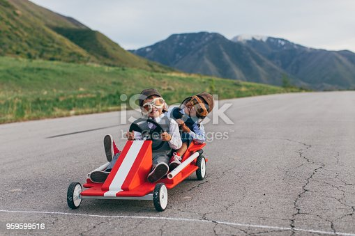 959599892 istock photo Young Business Team of Boys Racing Go Carts 959599516