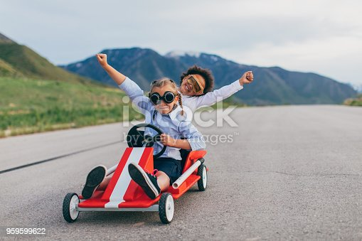 959599892 istock photo Young Business Team of Girls Win Go Cart Race 959599622