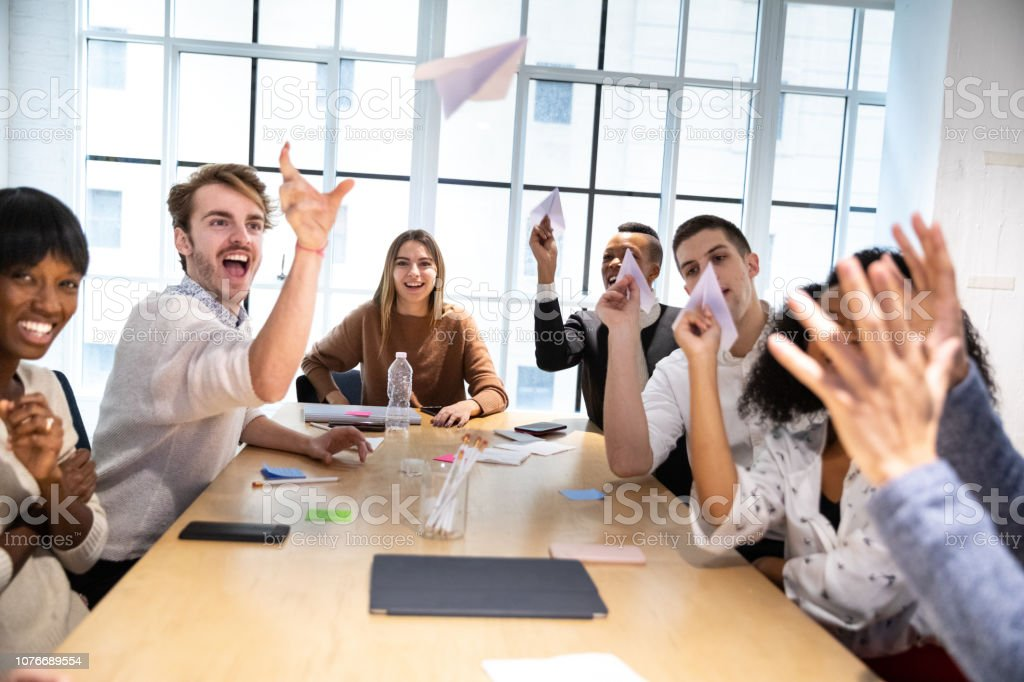 Young business team taking a break in the office stock photo