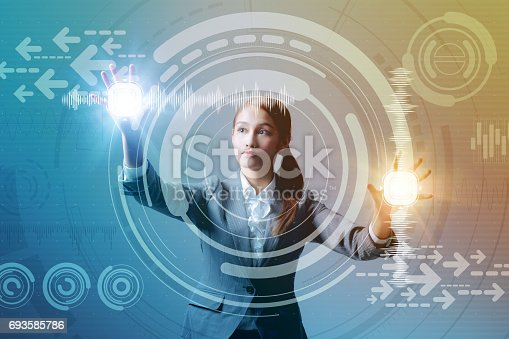 693586040istockphoto young business woman and futuristic graphical user interface concept, Internet of Things, Information Communication Technology, Heads up display, abstract mixed media 693585786