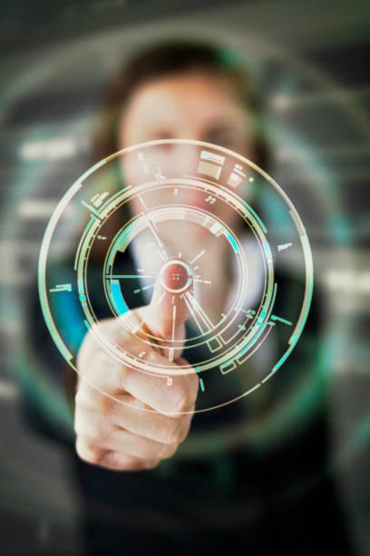 young business woman and futuristic graphical user interface - business woman hologram imagens e fotografias de stock